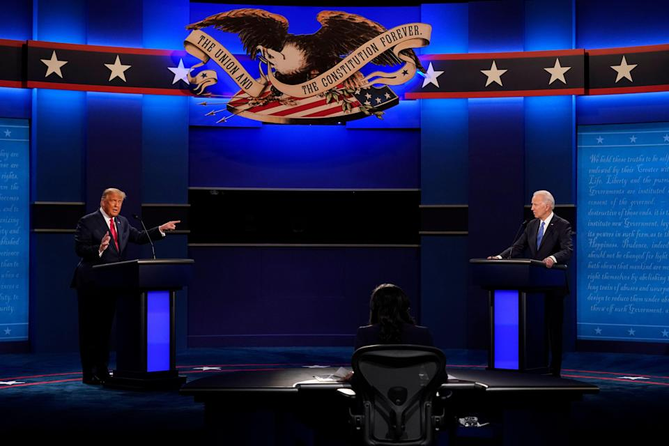 President Donald Trump points toward Democratic presidential candidate Joe Biden during the second and final presidential debate Thursday at Belmont University in Nashville. (ASSOCIATED PRESS)