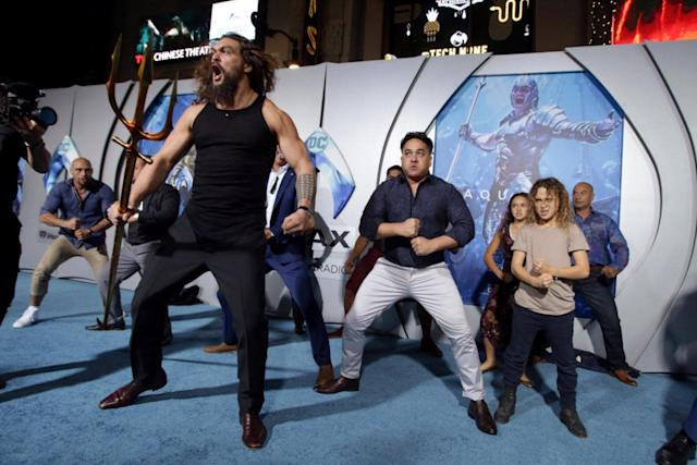 Upstaged: Jason Momoa with his children performing the traditional routine (Rex Features)