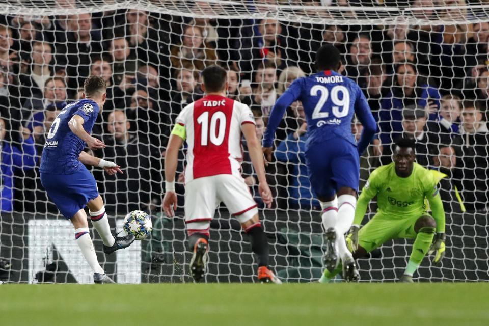Chelsea's Jorginho, left, scores a penalty his side's third goal during the group H Champions League soccer match between Chelsea and Ajax at Stamford Bridge in London, Tuesday, Nov. 5, 2019. (AP Photo/Frank Augstein)