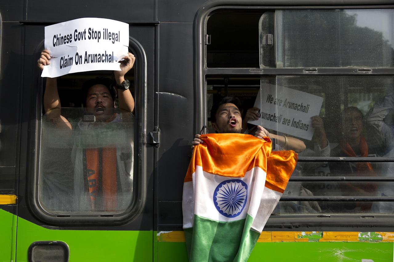<p>A small group of protestors from India's northeastern Arunachal Pradesh state shout slogans against China as they are detained by police near the Chinese embassy in New Delhi, India, after they protested against news reports of China announcing Chinese names for six districts in Arunachal Pradesh, Tuesday, April 25, 2017. China claims about 90,000 square kilometers (35,000 square miles) in Arunachal Pradesh, but India rejects that claim. (AP Photo/Tsering Topgyal) </p>