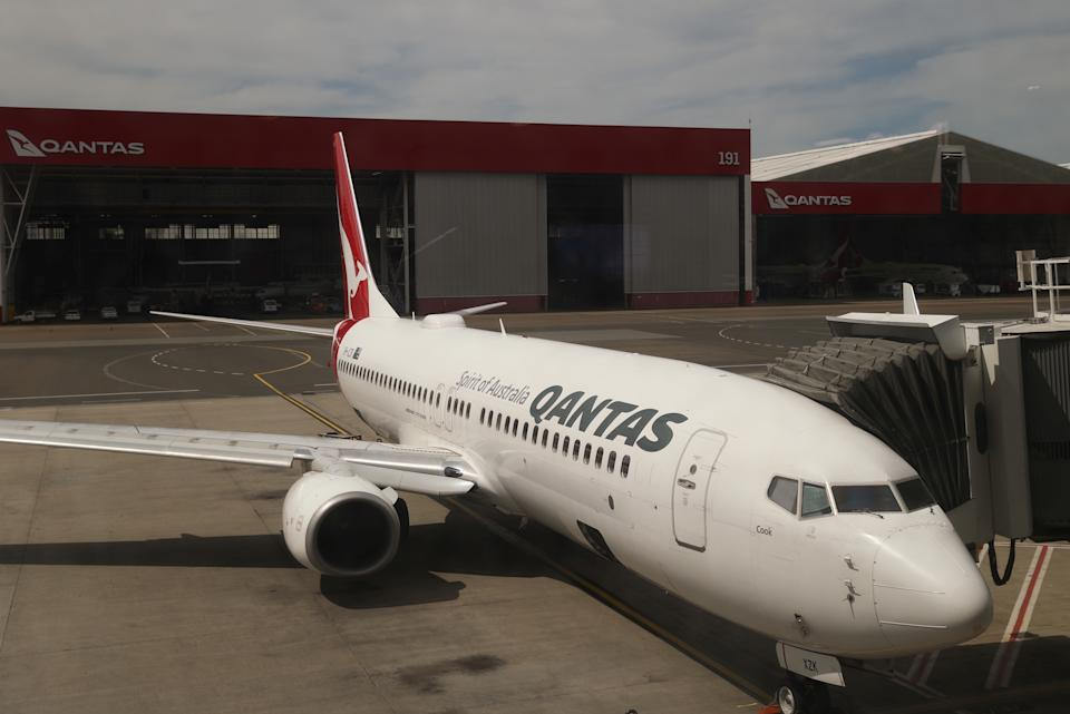 A Qantas plane is seen at a domestic terminal at Sydney Airport in Sydney.