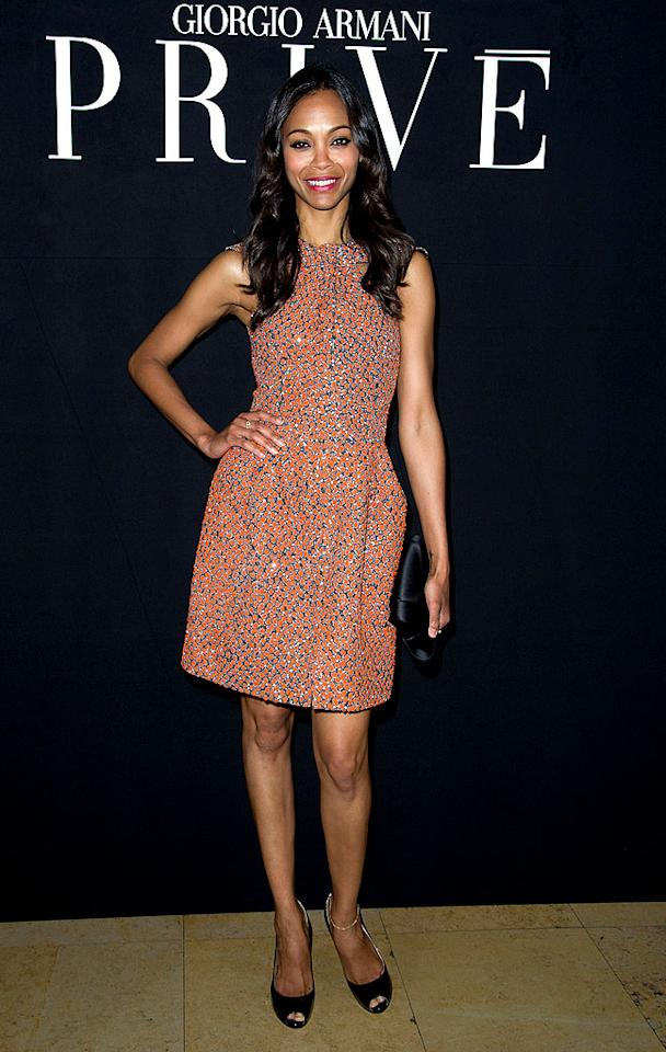 "Looking flawless from head-to-toe, ""Avatar"" star <a target=""_blank"" href=""http://movies.yahoo.com/person/zoe-saldana/"">Zoe Saldana</a> lit up the Armani fashion show in one of the designer's shiny, coral-colored halter dresses. Accessories included a smile and simple black peep-toes. (7/3/2012)"