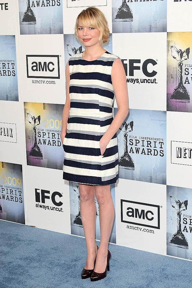 "Michelle Williams sported a chic Chloe-created striped sheath and black pumps at this year's Independent Spirit Awards. Jason Merritt/<a href=""http://www.gettyimages.com/"" target=""new"">GettyImages.com</a> - February 21, 2009"