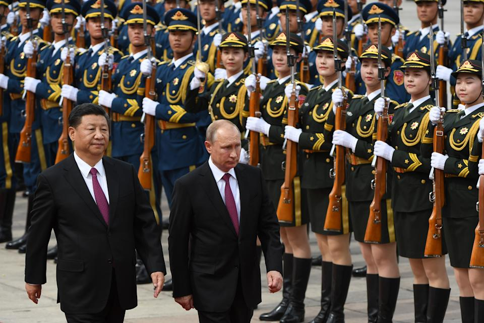 Russia's President Vladimir Putin  reviews a military honour guard with Chinese President Xi Jinping in 2018. Source: Getty