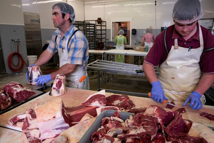 Glen Newswanger and Dwight Newswanger prepare beef orders at Newswanger Meats in Shiloh, Ohio, U.S., May 13, 2020 as the coronavirus disease (COVID-19) outbreak continues. Picture taken May 13, 2020.  REUTERS/Dane Rhys