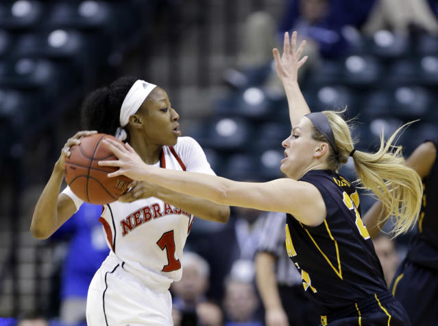 Iowa guard Melissa Dixon, right, fouls Nebraska guard Tear'a Laudermill in the first half of an NCAA college basketball game in the finals of the Big Ten women's tournament in Indianapolis, Sunday, March 9, 2014. (AP Photo/Michael Conroy)