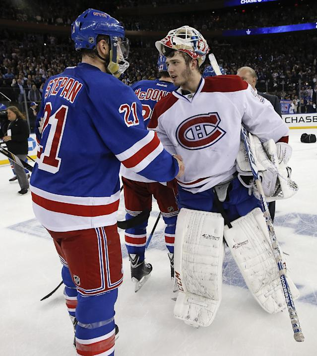 New York Rangers center Derek Stepan (21) greets Montreal Canadiens goalie Dustin Tokarski (35) after the Rangers beat the Montreal Canadiens 1-0 in Game 6 of the NHL hockey Stanley Cup playoffs Eastern Conference finals, Thursday, May 29, 2014, in New York