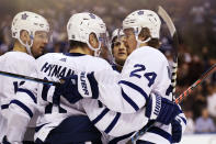 Toronto Maple Leafs right wing Kasperi Kapanen (24) is congratulated after his goal during the first period of the team's NHL hockey game against the Florida Panthers, Thursday, Feb. 27, 2020, in Sunrise, Fla. (AP Photo/Wilfredo Lee)