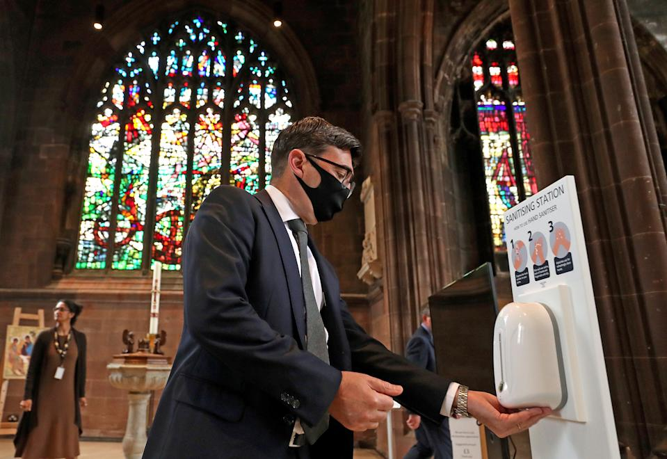 Rt. Hon. Andy Burnham, Mayor of Greater Manchester, sanitises his hands before a memorial service for the victims of coronavirus at Manchester Cathedral.