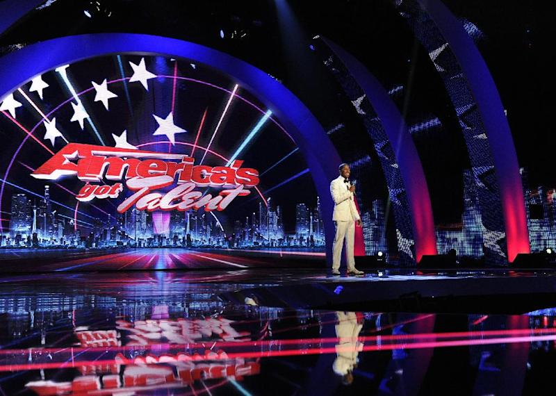 """This Sept. 14, 2012 photo released by NBC shows host Nick Cannon on stage during auditions for the talent competition series """"America's Got Talent,"""" in Newark, N.J. The new season of """"America's Got Talent"""" starts Tuesday at 9 p.m. EDT. New judges include former Spice Girl Mel B. and supermodel/personality Heidi Klum joining forces with Howie Mandel and Howard Stern. (AP Photo/NBC, Virginia Sherwood)"""