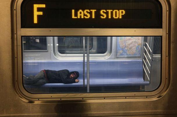 PHOTO: A person sleeps on a New York City subway car, May 7, 2020 in New York City. (Spencer Platt/Getty Images, FILE)
