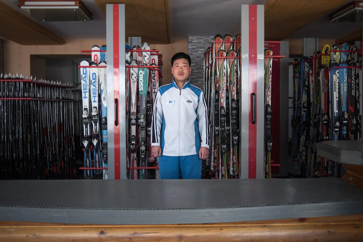 Kim Chol-Nam, 30, poses for a portrait at the ski hire desk where he works at the Masikryong, or Masik Pass, ski resort near Wonsan.