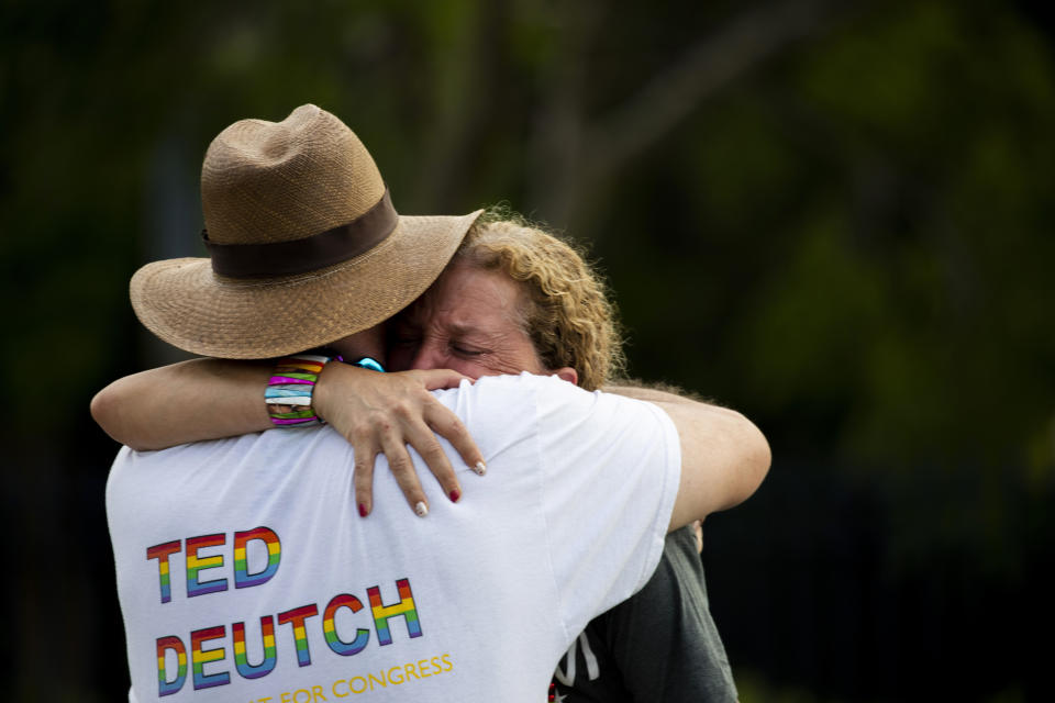Rep. Debbie Wasserman Schultz, D-Fla., is comforted after a truck drove into a crowd of people during The Stonewall Pride Parade and Street Festival in Wilton Manors, Fla., Saturday, June 19, 2021.