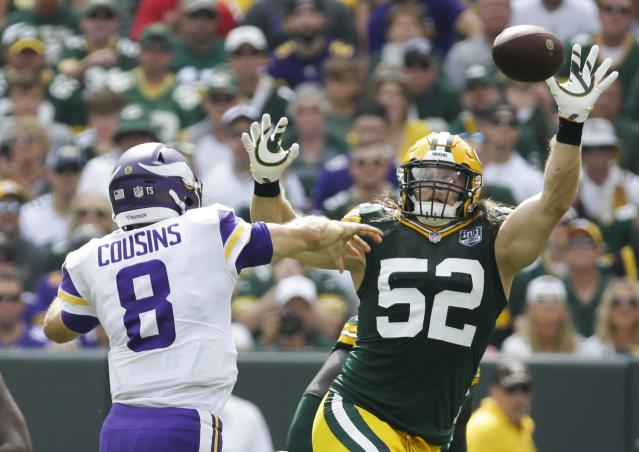 <p>Minnesota Vikings' Kirk Cousins throws over Green Bay Packers' Clay Matthews during the first half of an NFL football game Sunday, Sept. 16, 2018, in Green Bay, Wis. (AP Photo/Mike Roemer) </p>