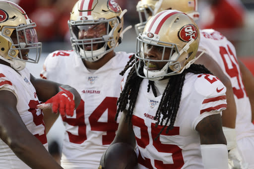 San Francisco 49ers cornerback Richard Sherman (25) celebrates with his teammates after his touchdown against the Tampa Bay Buccaneers during the second half an NFL football game, Sunday, Sept. 8, 2019, in Tampa, Fla. (AP Photo/Chris O'Meara)