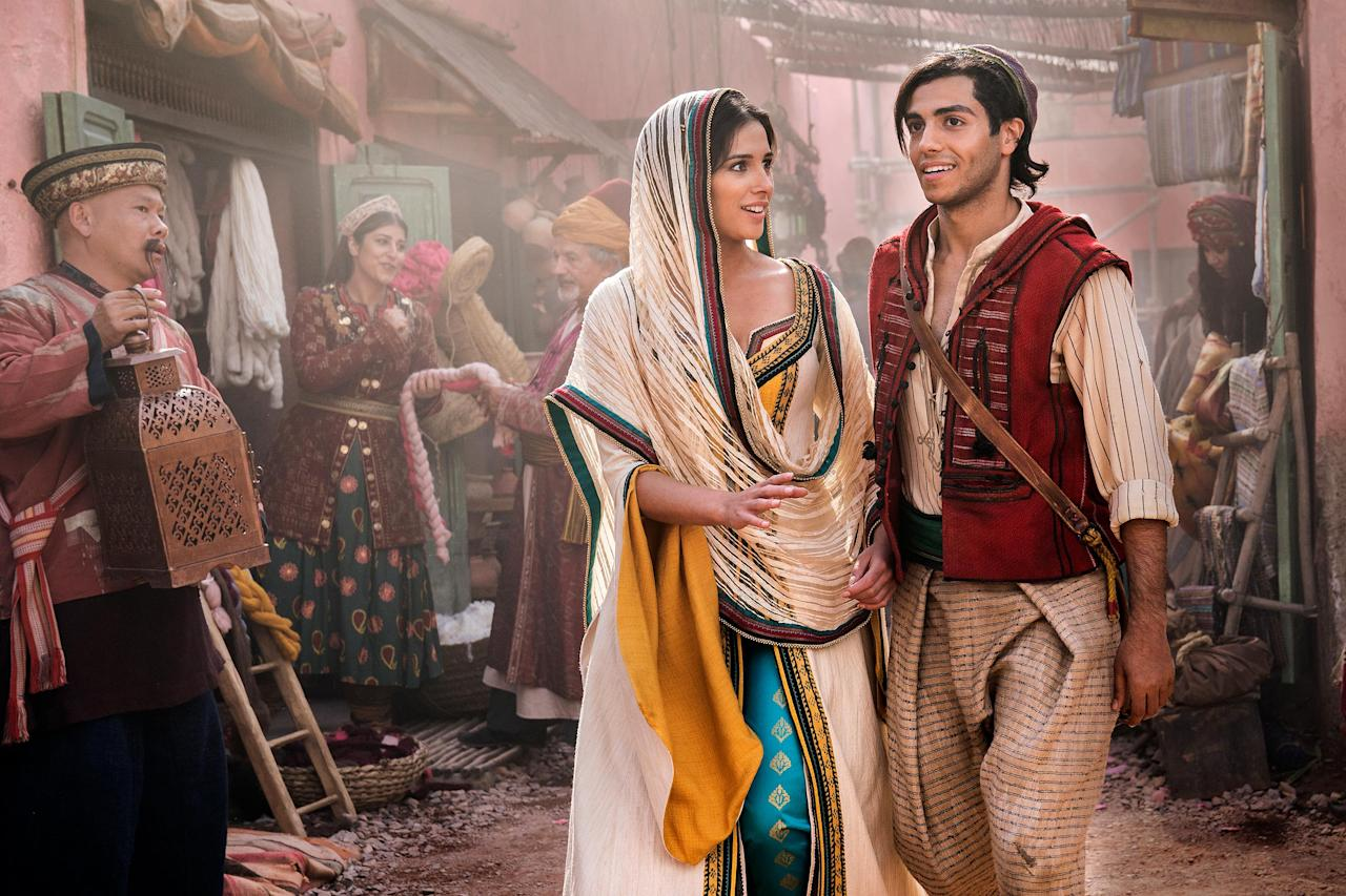 """<a href=""""https://ew.com/movies/2018/12/19/aladdin-first-look-ew-cover-story/""""><em>Aladdin</em></a> costume designer Michael Wilkinson created timeless garments from exquisite jewel-tone fabrics to help tell the story of a princess and a street rat, a sultan, and a vizier. Read on to see how he came up with the looks seen in the live-action film."""