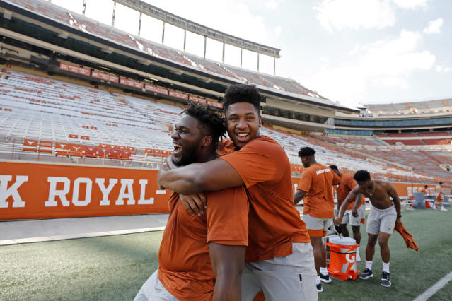 Texas Longhorns' Tope Imade (left) and Tyler Johnson joke during Family Friday practice held Friday Sept. 6, 2019 at Darrell K Royal-Texas Memorial Stadium in Austin, Tx. ( Photo by Edward A. Ornelas )