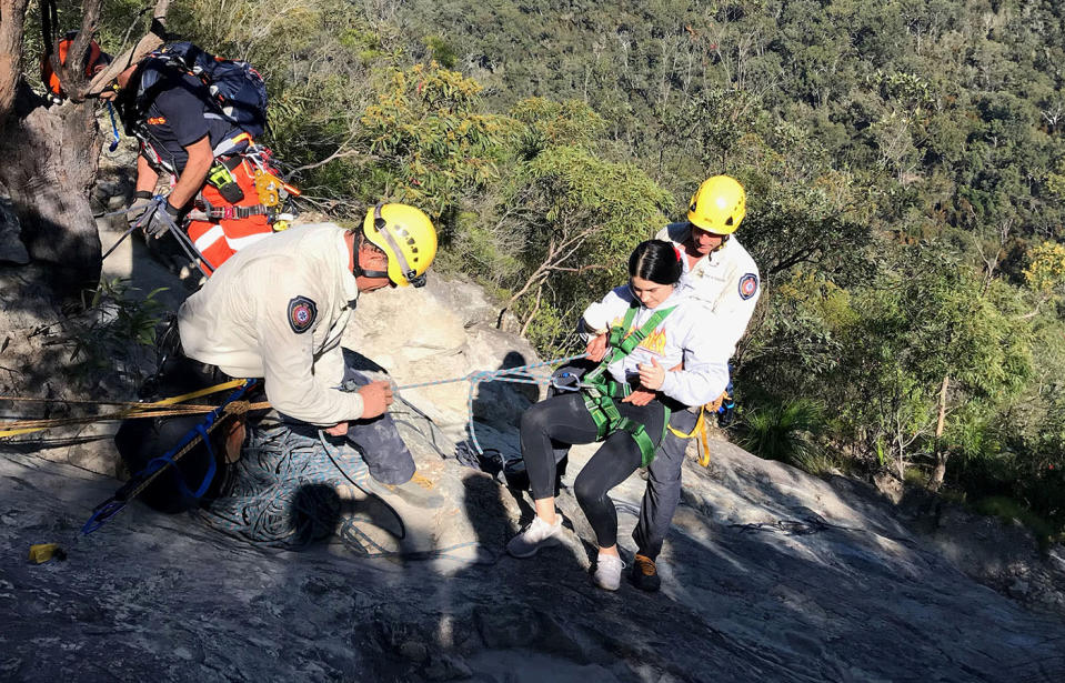 Sarah Wylie being rescued after she fell over on Mount Tibrogargan. Source: Caters