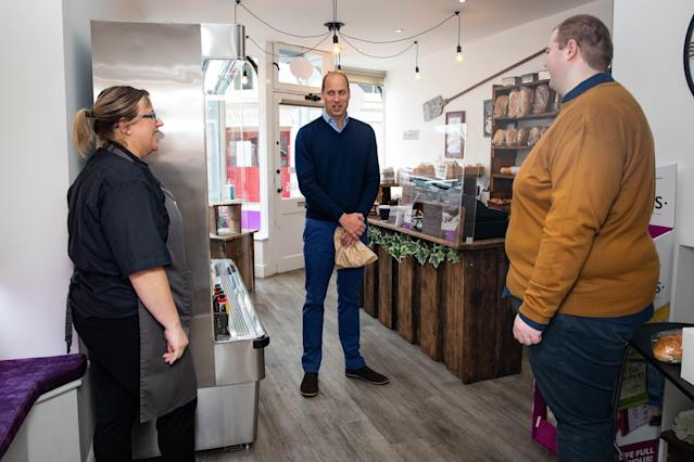 Prince William speaks to shop staff Sarah Easthall and Ted Bartram at Smiths the Bakers. (Getty Images)