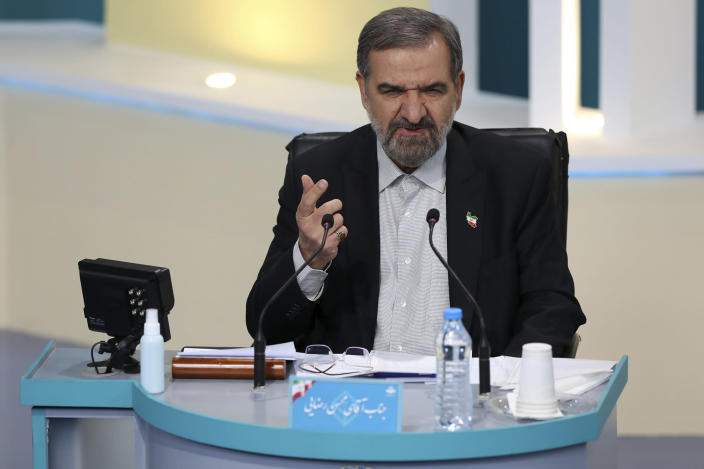 In this photo made available by the government-affiliated Young Journalists Club, presidential candidate Mohsen Rezaei speaks in a televised debate in a state-run television studio, in Tehran, Iran, on Saturday, June 5, 2021. Elections are scheduled for June 18. (Morteza Fakhri Nezhad/YJC via AP)