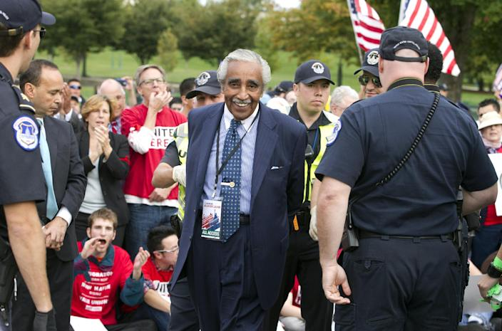 Rep. Charles Rangel, D-N.Y., is arrested by U.S. Capitol Police officers on Capitol Hill during a immigration rally in Washington, Tuesday, Oct. 8, 2013. ( AP Photo/Jose Luis Magana)