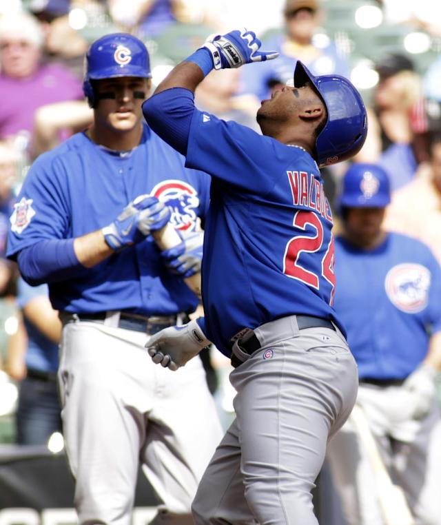 Chicago Cubs' Luis Valbuena, right, gestures skyward as he crosses home plate after hitting a home run against the Milwaukee Brewers in the first inning of a baseball game Thursday, Sept. 19, 2013, in Milwaukee. (AP Photo/Darren Hauck)
