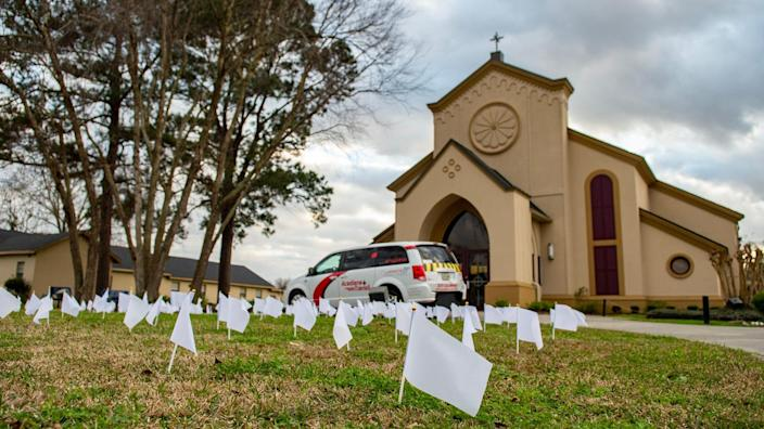 Hundreds of white flags line the lawn of Immaculate Heart of Mary Catholic Church as part of a memorial to people in Lafayette Parish, La., who have died from COVID-19.