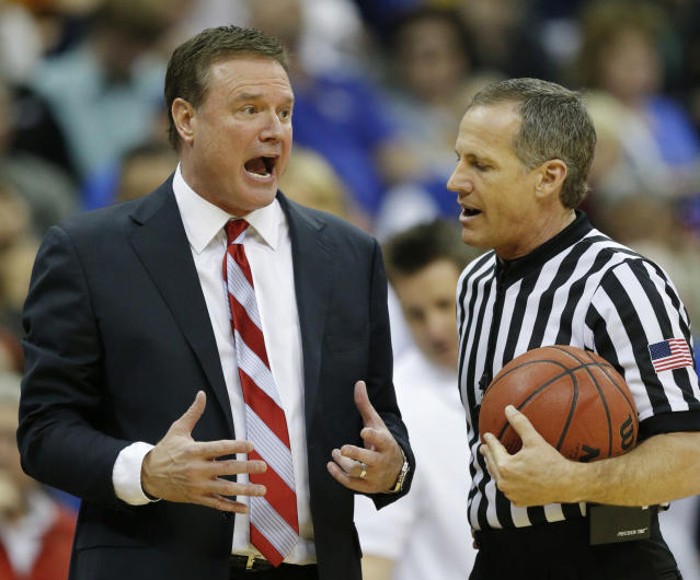 Kansas head coach Bill Self, left, talks with a referee during the second half of an NCAA college basketball game against Iowa State in the semifinals of the Big 12 Conference men's tournament in Kansas City, Mo., Friday, March 14, 2014. Iowa State defeated Kansas 94-83. (AP Photo/Orlin Wagner)