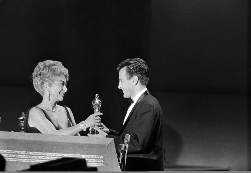 "FILE - In this April 9, 1962 file picture Joan Crawford, acting as presenter for the Academy of Motion Picture Arts and Sciences, presents an Oscar to Maximilian Schell on the stage at Santa Monica, Calif., April 9, 1962, after he was named as best actor of the year for his performance in ""Judgment at Nuremberg."" Austrian actor Maximilian Schell, who won the best actor Oscar in the early 1960s has died. He was 83. Schell's agent Patricia Baumbauer said Saturday Feb. 1, 2014 that Schell died overnight at a hospital in Innsbruck following a ""sudden and serious illness,"" the Austria Press Agency reported. Born to a Swiss writer and an Austrian actress, he was the younger brother of Maria Schell, an icon of the German-speaking film world, who died in 2005. (AP Photo,File)"