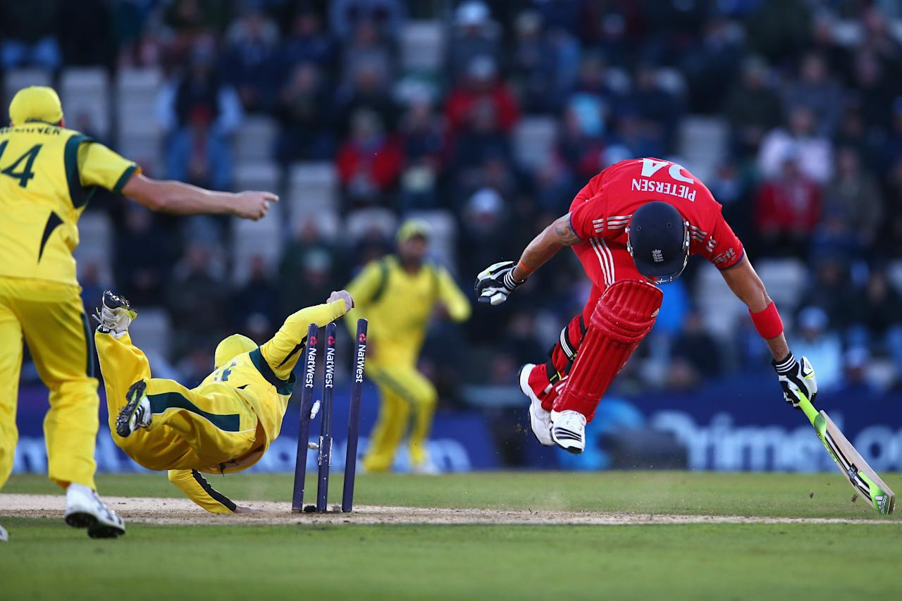 SOUTHAMPTON, ENGLAND - SEPTEMBER 16:  Kevin Pietersen of England is run out by Phil Hughes of England of Australia during the 5th NatWest Series ODI between England and Australia at the Ageas Bowl on September 16, 2013 in Southampton, England.  (Photo by Michael Steele/Getty Images)