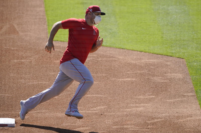 The Los Angeles Angels practice at Angels Stadium on Friday, July 3, 2020, in Anaheim, Calif. (AP Photo/Ashley Landis)