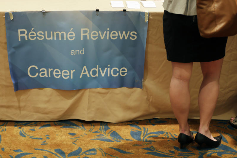 In this Monday, June 24, 2013, photo, a job seeker gets her resume critiqued at a career fair, in King of Prussia, Pa. U.S. employers added a robust 195,000 jobs in June and many more in April and May than previously thought. The job growth raises hopes for a stronger economy in the second half of 2013. (AP Photo/Matt Slocum)
