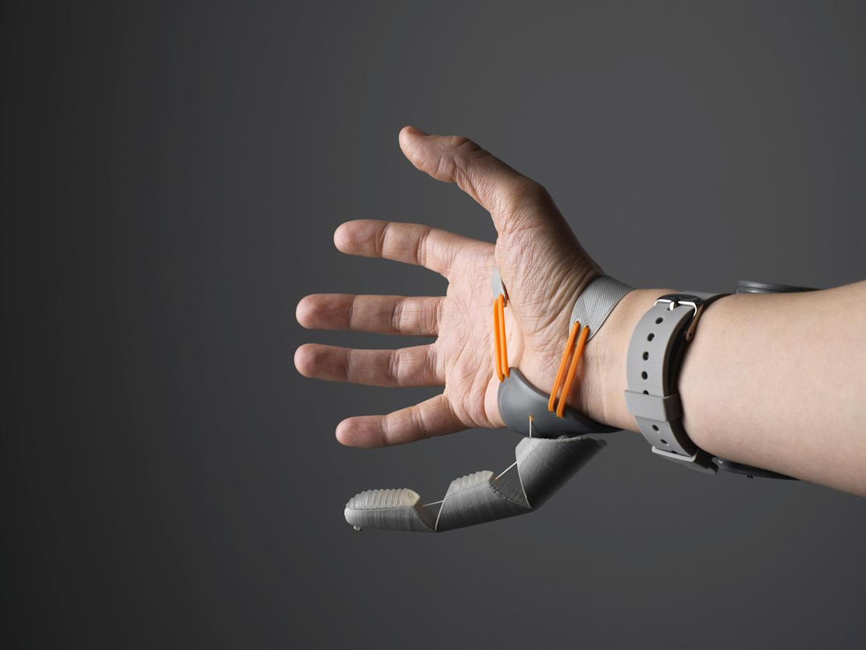 Study participants who wore an additional robotic thumb, attaching below the pinky finger, adapted so naturally they were even able to complete tasks like building a tower of blocks...blindfolded. (SWNS)