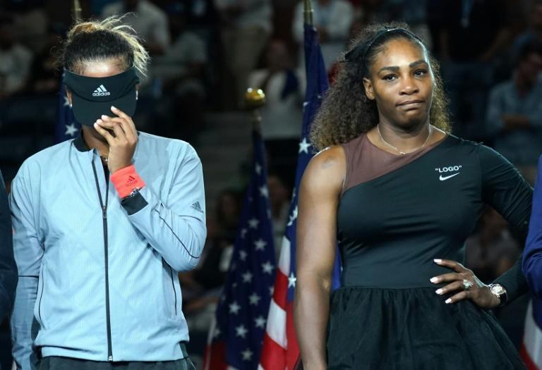 Naomi Osaka hides her tears during the presentation after beating Serena Williams to win the 2019 US Open