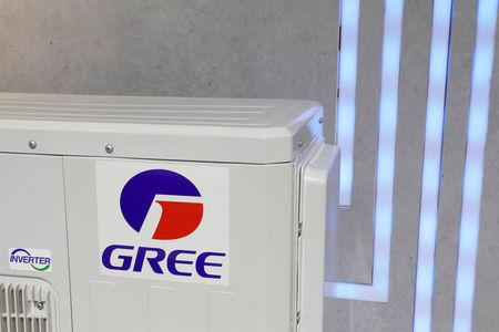 The logo of Chinese appliance manufacturer Gree is seen on a air conditioner at its booth during the China Import and Export Fair, also known as Canton Fair, in the southern city of Guangzhou, China April 16, 2018. REUTERS/Tyrone Siu