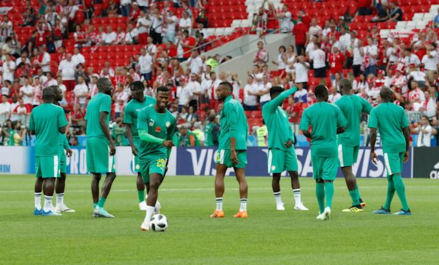 Soccer Football - World Cup - Group H - Poland vs Senegal - Spartak Stadium, Moscow, Russia - June 19, 2018 Senegal's Keita Balde and team mates warm up before the match REUTERS/Christian Hartmann