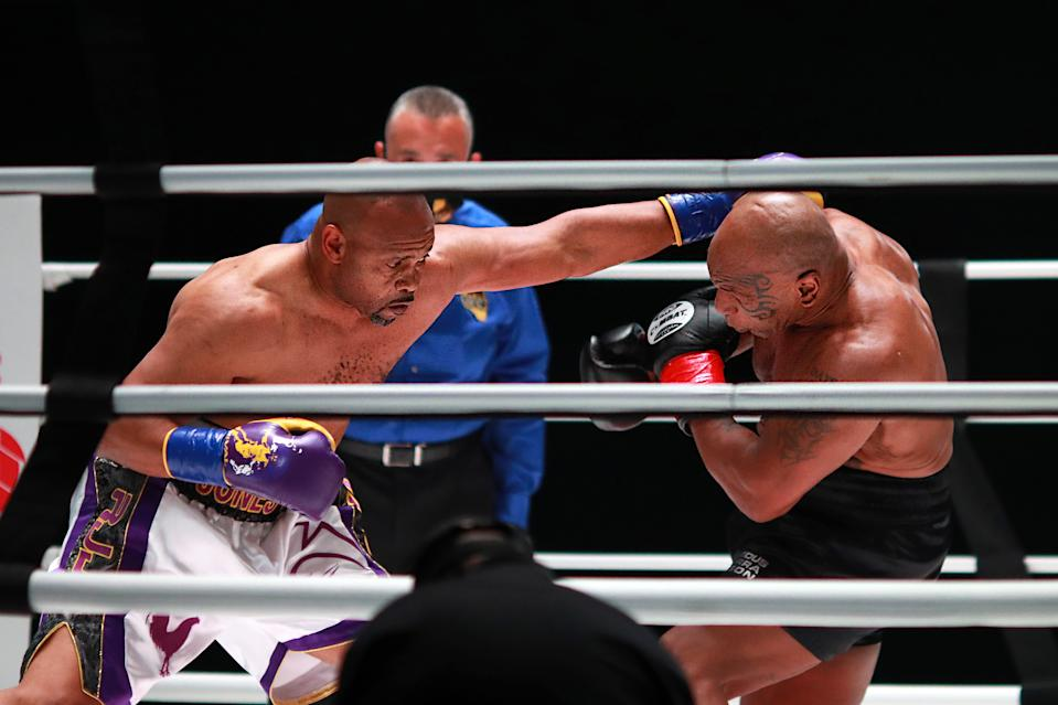 LOS ANGELES, CALIFORNIA - NOVEMBER 28: Roy Jones Jr. throws a punch in the second round against Mike Tyson during Mike Tyson vs Roy Jones Jr. presented by Triller at Staples Center on November 28, 2020 in Los Angeles, California. (Photo by Joe Scarnici/Getty Images for Triller)