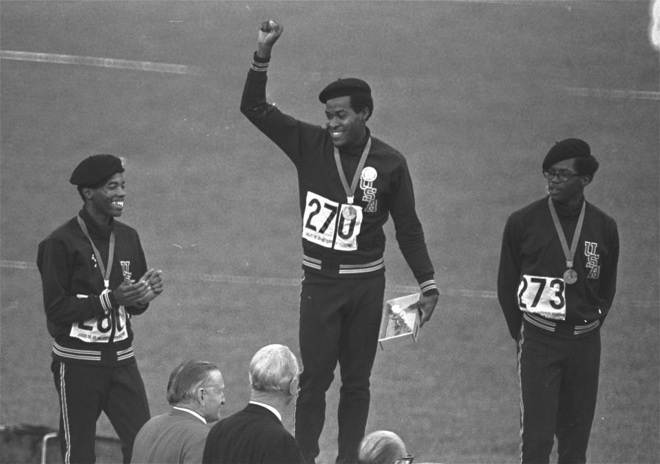 FILE - United States runners Larry James, left, Lee Evans, center, and Ron Freeman are shown after receiving their medals for the 400-meter race at the Mexico City Games in Mexico City, in this Oct. 18, 1968, file photo. Evans won gold, James took silver and Freeman got the bronze medal. Lee Evans, the record-setting sprinter who wore a black beret in a sign of protest at the 1968 Olympics, died Wednesday, May 19, 2021. He was 74. USA Track and Field confirmed Evans' death. The San Jose Mercury News reported that Evans' family had started a fundraiser with hopes of bringing him back to the U.S. from Nigeria, where he coached track, to receive medical care after he suffered a stroke last week.(AP Photo/File)