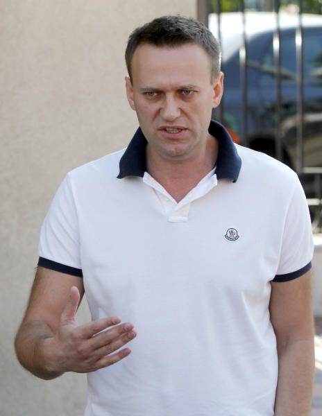 Russian protest leader Alexei Navalny speaks to the media as he arrives for questioning at the headquarters of the Russian Investigation committee in Moscow, Russia, Tuesday, July 31, 2012. (AP Photo/Misha Japaridze)