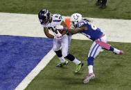 Seattle Seahawks wide receiver Golden Tate, left, breaks the tackle of Indianapolis Colts cornerback Greg Toler to score a touchdown during the first half of an NFL football game in Indianapolis, Sunday, Oct. 6, 2013. (AP Photo/AJ Mast)