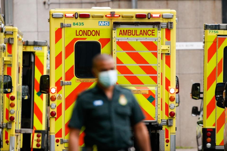 A paramedic walks past ambulances outside the emergency department of the Royal London Hospital in London, England, on January 26, 2021. Data from the UK's official statistics bodies revealed today that, based on death certificates, up to January 15 this year nearly 104,000 people have died with coronavirus since the pandemic began. Government figures, which are based on deaths within 28 days of a positive covid-19 test, remain slightly lower, yesterday standing at 98,531. (Photo by David Cliff/NurPhoto via Getty Images)