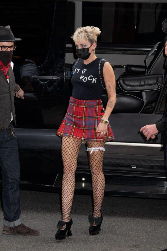 Miley Cyrus arrives back at her hotel after 'Saturday Night Live' rehearsals in New York, May 6. - Credit: RCF/MEGA