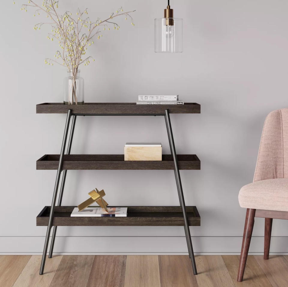 """<h2>Console Tables<br></h2><br><h3>Project 62 Hillside Console Table </h3><br>Instead of trying to budget out a living-space lineup with multiple bookshelves, side tables, and entertainment consoles, invest in one piece that can pull triple-duty while streamlining all your grown-up <em>stuff</em>.<br><br><em>Shop <a href=""""https://goto.target.com/DVeV32"""" rel=""""nofollow noopener"""" target=""""_blank"""" data-ylk=""""slk:Target"""" class=""""link rapid-noclick-resp""""><strong>Target</strong></a></em><br><br><strong>Project 62</strong> Hillside Console Table Espresso Brown, $, available at <a href=""""https://go.skimresources.com/?id=30283X879131&url=https%3A%2F%2Fgoto.target.com%2FDVeV32"""" rel=""""nofollow noopener"""" target=""""_blank"""" data-ylk=""""slk:Target"""" class=""""link rapid-noclick-resp"""">Target</a>"""