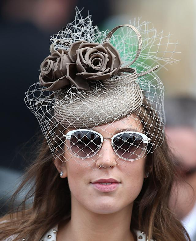 A fashionable racegoer on Day Four of The Royal Ascot Meeting 2013