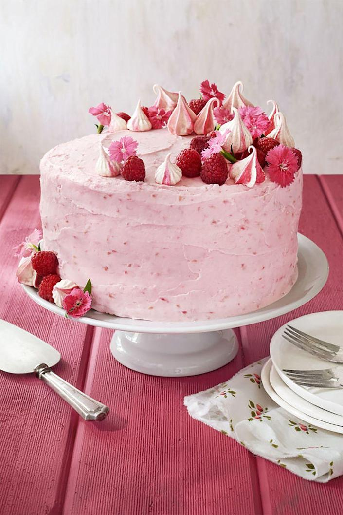 """<p>Mom will be amazed by this glorious red velvet cake, which is covered in raspberry cream cheese and topped off with meringue kisses, edible flowers, and raspberries. </p><p><strong><a href=""""https://www.countryliving.com/food-drinks/recipes/a41986/raspberry-pink-velvet-cake-recipe/"""" rel=""""nofollow noopener"""" target=""""_blank"""" data-ylk=""""slk:Get the recipe"""" class=""""link rapid-noclick-resp"""">Get the recipe</a>.</strong></p><p><a class=""""link rapid-noclick-resp"""" href=""""https://go.redirectingat.com?id=74968X1596630&url=https%3A%2F%2Fwww.williams-sonoma.com%2Fproducts%2Fkitchenaid-artisan-mini-with-flex-edge-beater%2F&sref=https%3A%2F%2Fwww.countryliving.com%2Ffood-drinks%2Fg3185%2Fmothers-day-cakes%2F"""" rel=""""nofollow noopener"""" target=""""_blank"""" data-ylk=""""slk:SHOP STAND MIXERS"""">SHOP STAND MIXERS</a></p>"""
