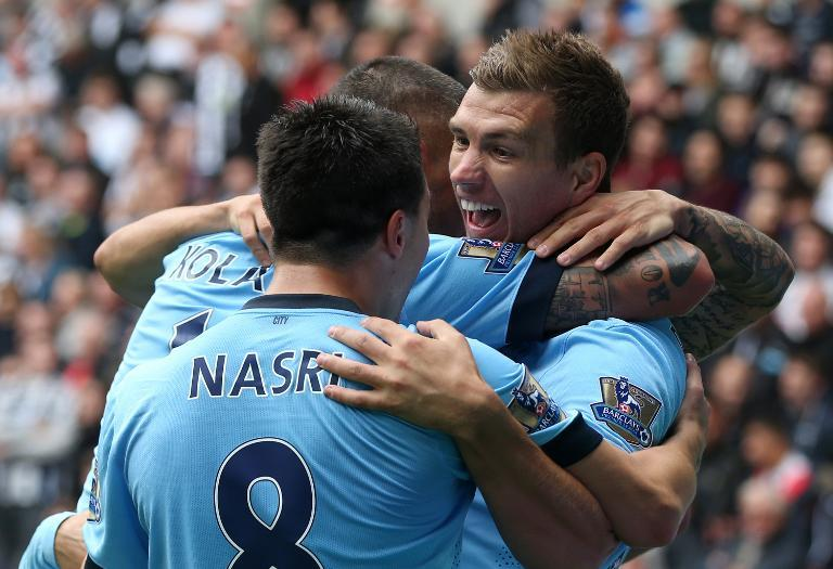 Manchester City's Samir Nasri celebrates with his teammates during their Premier League opening match against Newcastle United in Newcastle-upon-Tyne on August 17, 2014 (AFP Photo/Ian Macnicol)