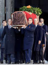 Relatives carry the coffin with the remains of Spanish dictator General Francisco Franco at the Valley of the Fallen mausoleum near El Escorial, outskirts of Madrid, Spain, Thursday, Oct. 24, 2019. Spain is exhuming the remains of Spanish dictator Gen. Francisco Franco from his grandiose mausoleum outside Madrid so he can be reburied in a small family crypt north of the capital. (AP Photo/Juan Carlos Hidalgo, Pool)