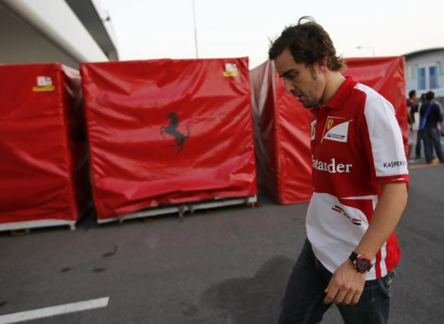 Ferrari Formula One driver Fernando Alonso of Spain walks on the paddock after the Japanese F1 Grand Prix at the Suzuka circuit October 13, 2013. REUTERS/Toru Hanai (JAPAN - Tags: SPORT MOTORSPORT F1)