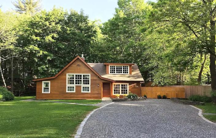 """<p><strong>Woodstock, New York</strong></p> <p>Take a road trip through upstate New York with views of one of the highest peaks in the area, Overlook Mountain. The cozy Brook Cottage is part of an artist's residence, renovated in 1928, and the windows have north-facing light that lets beautiful rays inside the one-bedroom cottage with a king-size bed. Don't forget to have your morning tea or coffee in the living room on the crisp white couch, or fire up a recipe on the patio with the gas <a href=""""https://www.architecturaldigest.com/story/best-grills?mbid=synd_yahoo_rss"""" rel=""""nofollow noopener"""" target=""""_blank"""" data-ylk=""""slk:grill"""" class=""""link rapid-noclick-resp"""">grill</a> and <a href=""""https://www.architecturaldigest.com/gallery/best-fire-pits?mbid=synd_yahoo_rss"""" rel=""""nofollow noopener"""" target=""""_blank"""" data-ylk=""""slk:fire pit"""" class=""""link rapid-noclick-resp"""">fire pit</a>.</p> $250, Airbnb. <a href=""""https://www.airbnb.com/rooms/25130115"""" rel=""""nofollow noopener"""" target=""""_blank"""" data-ylk=""""slk:Get it now!"""" class=""""link rapid-noclick-resp"""">Get it now!</a>"""