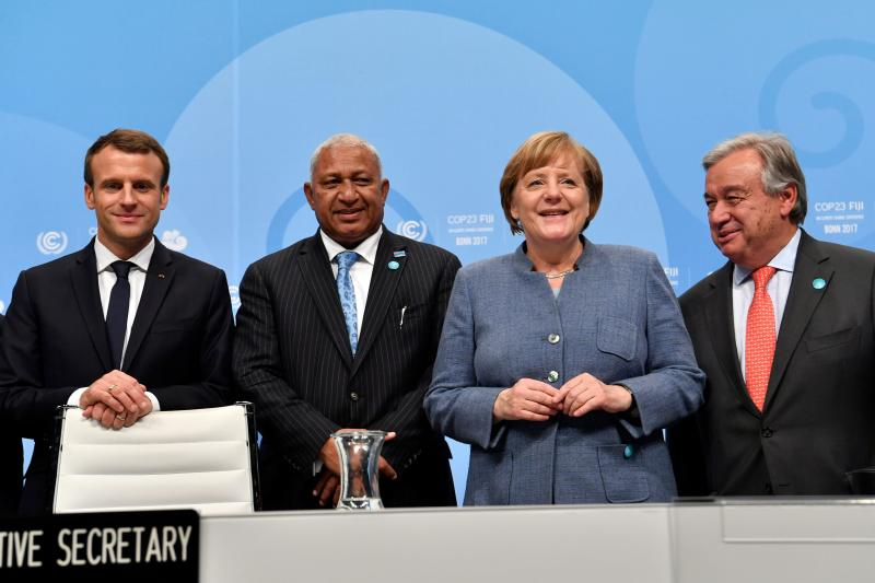 From left to right: French President Emmanuel Macron; prime minister of Fiji and president of COP 23 Frank Bainimarama; German Chancellor Angela Merkel; and UN Secretary-General Antonio Guterres. The leaders pose on Wednesday before the opening session of the United Nations' conference on climate change in Bonn, Germany. (JOHN MACDOUGALL via Getty Images)